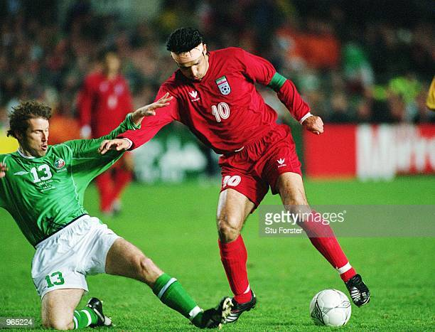 Ali Daei of Iran on the ball as Ireland's Kenny Cunningham comes in to tackle during the FIFA 2002 World Cup Playoff match between Republic of...