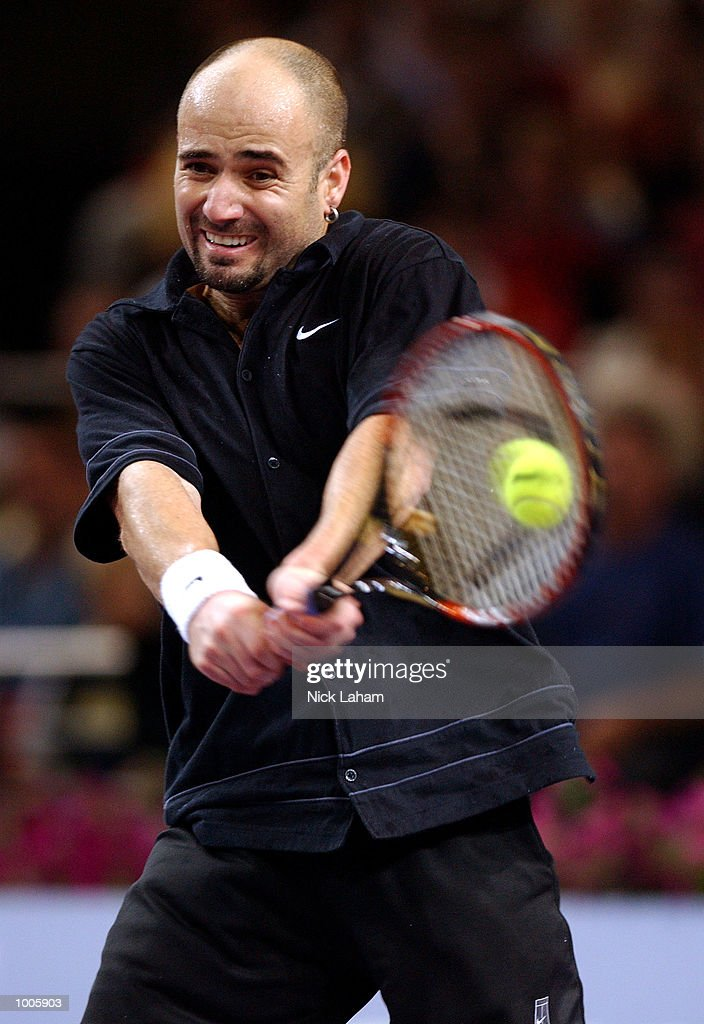 Andre Agassi of the United States in action during his match against Sebastien Grosjean of France during the Tennis Masters Cup held at the Sydney Superdome, Sydney, Australia. DIGITAL IMAGE Mandatory Credit: Nick Laham/ALLSPORT