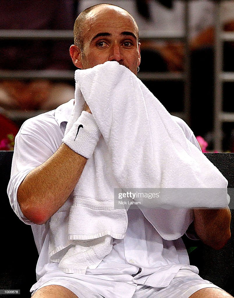 Andre Agassi of the United States in between games in his match against Lleyton Hewitt of Australia during the Tennis Masters Cup held at the Sydney Superdome, Sydney, Australia. DIGITAL IMAGE Mandatory Credit: Nick Laham/ALLSPORT