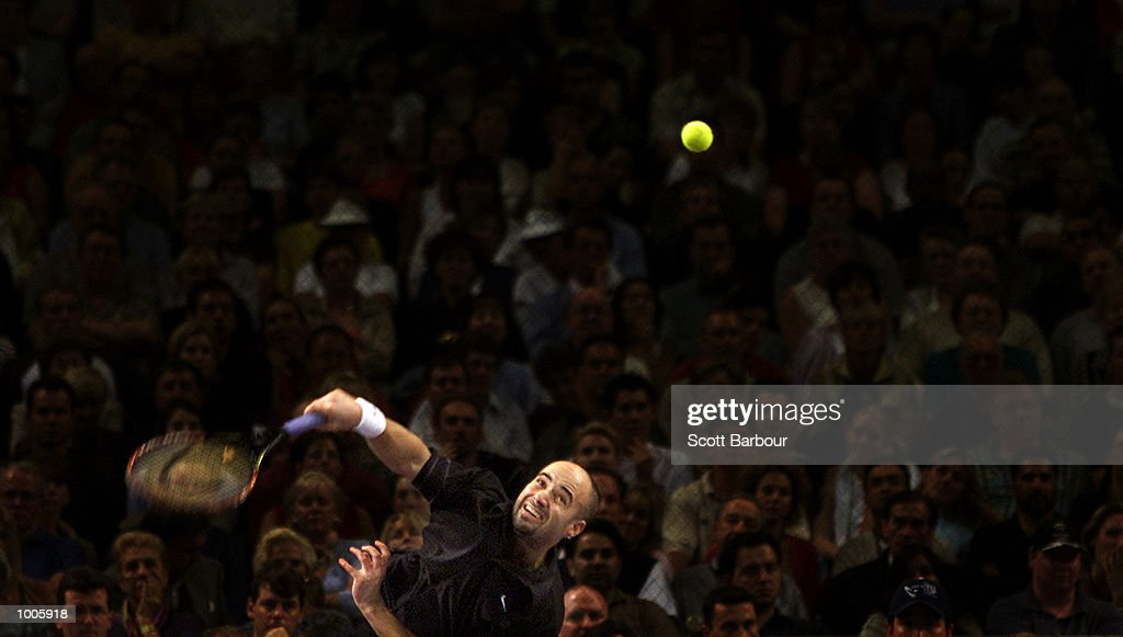 Andre Agassi of USA in action during his loss to Sebastien Grojean of France during day four of the Tennis Masters Cup held at the Sydney Superdome in Sydney, Australia. DIGITAL IMAGE. Mandatory Credit: Scott Barbour/ALLSPORT