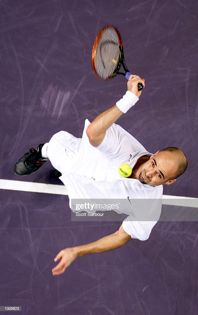 Andre Agassi of USA in action during his match against Lleyton Hewitt of Australia during day three of the Tennis Masters Cup held at the Sydney Superdome in Sydney, Australia. DIGITAL IMAGE. Mandatory Credit: Scott Barbour/ALLSPORT