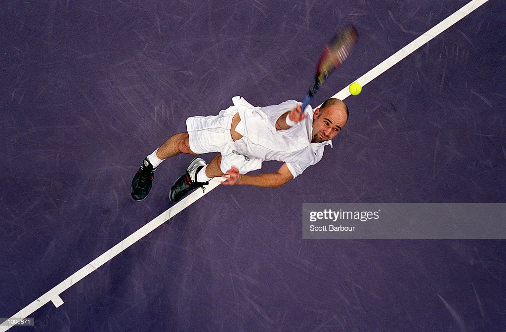 Andre Agassi of USA in action during his match against Lleyton Hewitt of Australia during day three of the Tennis Masters Cup held at the Sydney Superdome in Sydney, Australia. Mandatory Credit: Scott Barbour/ALLSPORT