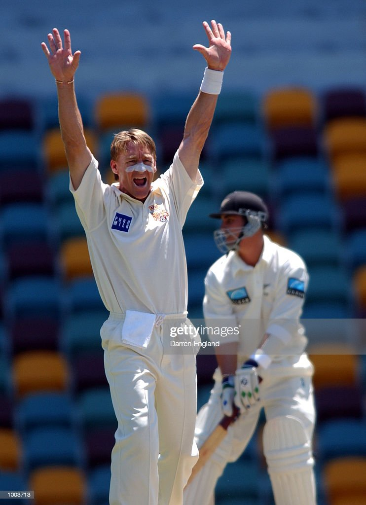 Andy Bichel of Queensland unsuccessfully appeals for the wicket of Mathew Sinclair of New Zealand during the New Zealand cricket teams tour match against Queensland played at the Gabba in Brisbane, Australia. DIGITAL IMAGE. Mandatory Credit: Darren England/ALLSPORT