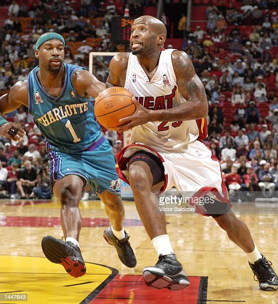 Anthony Carter of the Miami Heat drives to the basket against Baron Davis of the Charlotte Hornets in the second half of NBA action at the American...