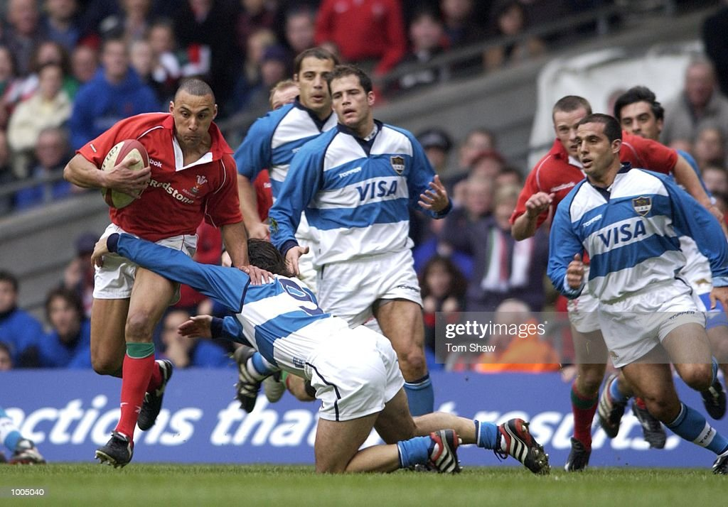 Anthony Sullivan of Wales evades a tackle during the Wales v Argentina International friendly match at the Millennium Stadium, Cardiff. DIGITAL IMAGE. Mandatory Credit: Tom Shaw/ALLSPORT