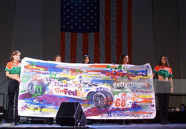 Artist Randy Owens has one of his pieces auctioned at the Runway Madness CARA Charity event at the Marlboro 500 round twenty one of the CART FedEx...