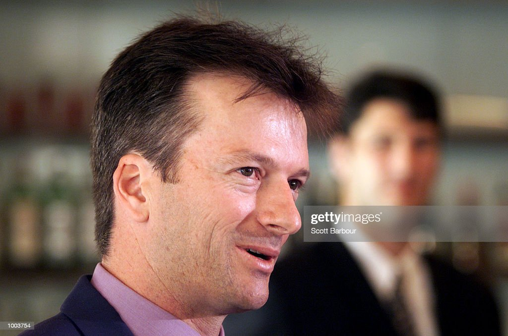 Australian cricket captain Steve Waugh (left) speaks watched by former Australian rugby captain John Eales during the launch of his new book ''Ashes Diary 2001''. The book launch was held at the Park Hyatt in Sydney, Australia. DIGITAL IMAGE. Mandatory Credit: Scott Barbour/ALLSPORT