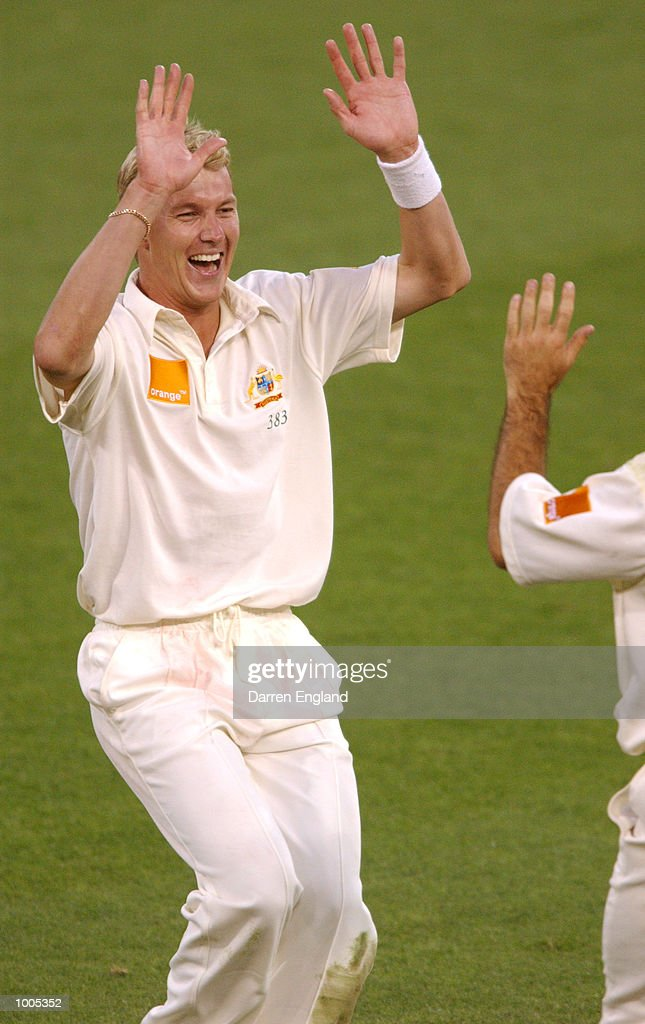 Brett Lee of Australia celebarets with team mate Ricky Ponting the wicket of Chris Cairns of New Zealand for 43 runs during day five of the first Cricket test between Australia and New Zealand played at the Gabba in Brisbane, Australia. DIGITAL IMAGE. Mandatory Credit: Darren England/ALLSPORT