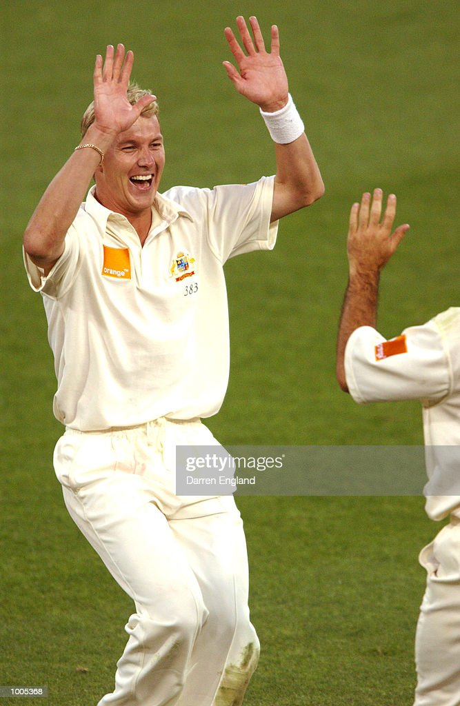 Brett Lee of Australia celebrates with team mate Ricky Ponting the wicket of Chris Cairns of New Zealand for 43 runs during day five of the first Cricket test between Australia and New Zealand played at the Gabba in Brisbane, Australia. DIGITAL IMAGE. Mandatory Credit: Darren England/ALLSPORT