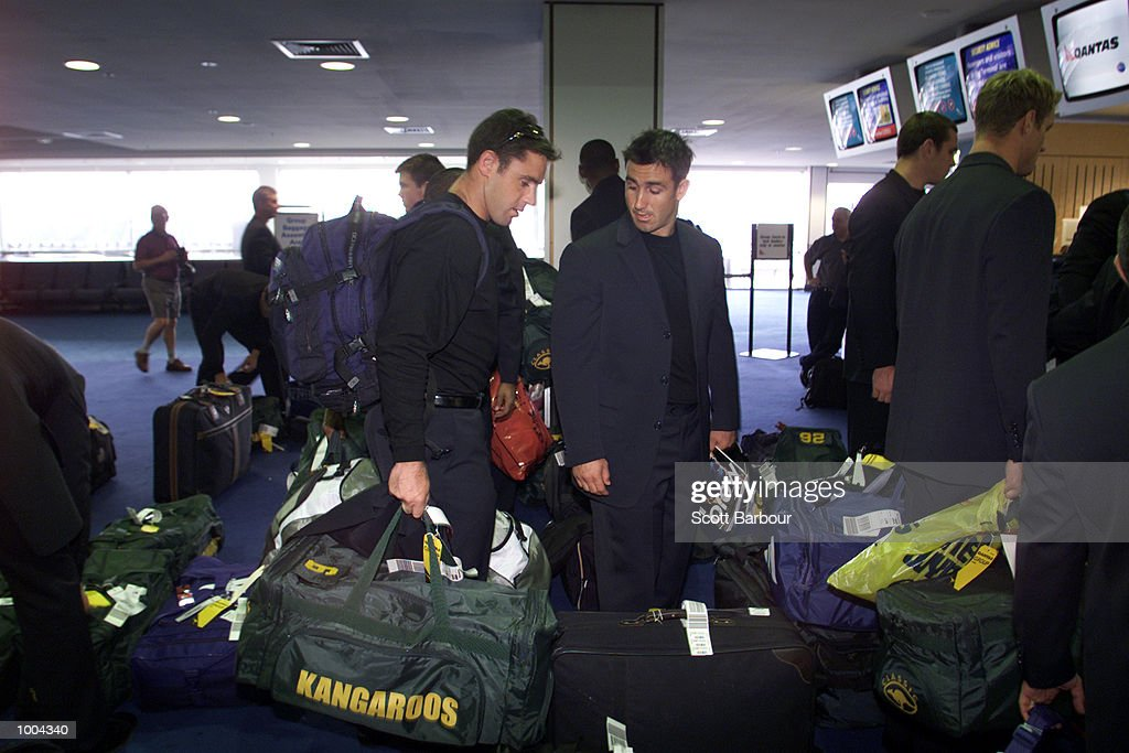 Captain Brad Fittler (left) and Andrew Johns wait to check their bags in before the Australian Kangaroos rugby league team depart for their tour of Engaland at Sydney International Airport in Sydney, Australia. DIGITAL IMAGE. Mandatory Credit: Scott Barbour/ALLSPORT