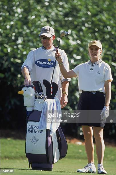 Catriona Matthew standing next to her caddie pulling out a club during the Tyco/ADT Championship part of the LPGA Tour Championship at the Trump...