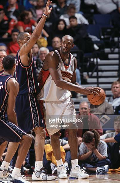 Center Erick Dampier of the Golden State Warriors posts up forward Kenyon Martin of the New Jersey Nets during the NBA game at the Arena in Oakland...