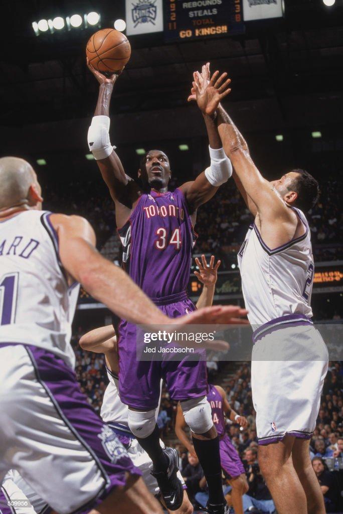 ee75ee9ddb5 Hakeem Olajuwon shoots the ball past Vlade Divac. 14 Nov 2001  Center  Hakeem Olajuwon  34 of the Toronto Raptors ...