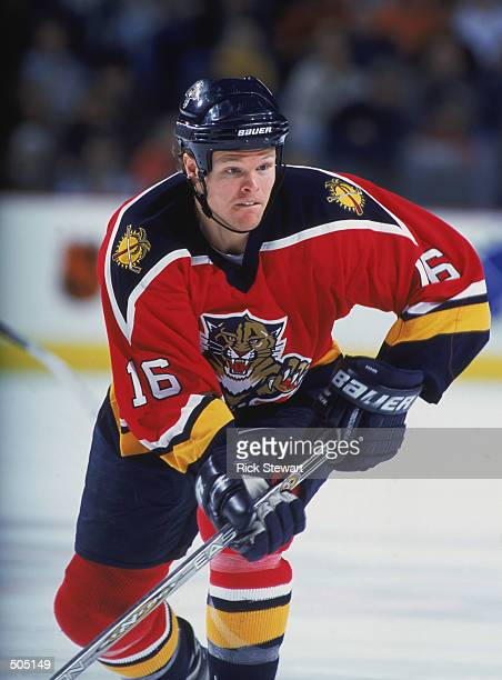 Center Kevyn Adams of the Florida Panthers eyes the play against the Buffalo Sabres during the NHL game at HSBC Arena in Buffalo New York The...