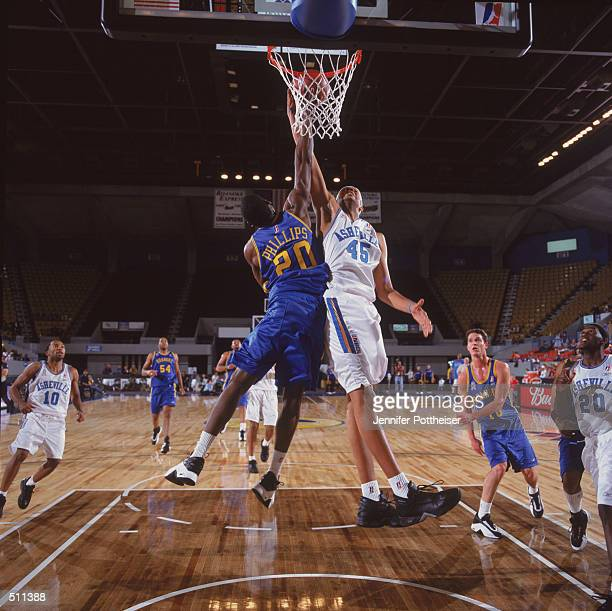 Center Lee Scruggs of the Asheville Altitude shoots over forward Marshall Phillips of the Roanoke Dazzle during the NBDL game at the Roanoke Civic...