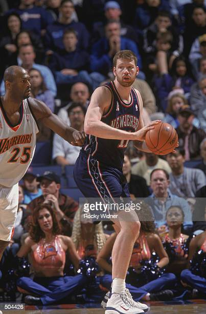 Center Todd MacCulloch of the New Jersey Nets holds the ball during the NBA game against the Golden State Warriors at the Arena in Oakland in Oakland...