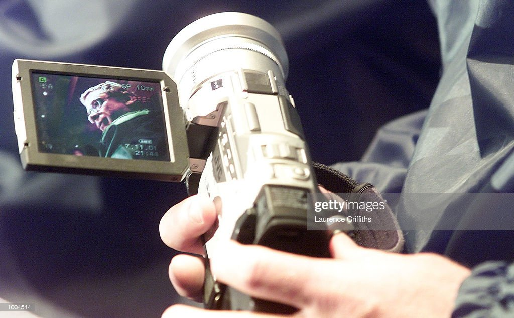 Chris Anderson of Australia is filmed by Brad Fittler's video camera for his personal video of the tour during a press conference at the Marriott Hotel in Leeds. DIGITAL IMAGE. Mandatory Credit: Laurence Griffiths/ALLSPORT