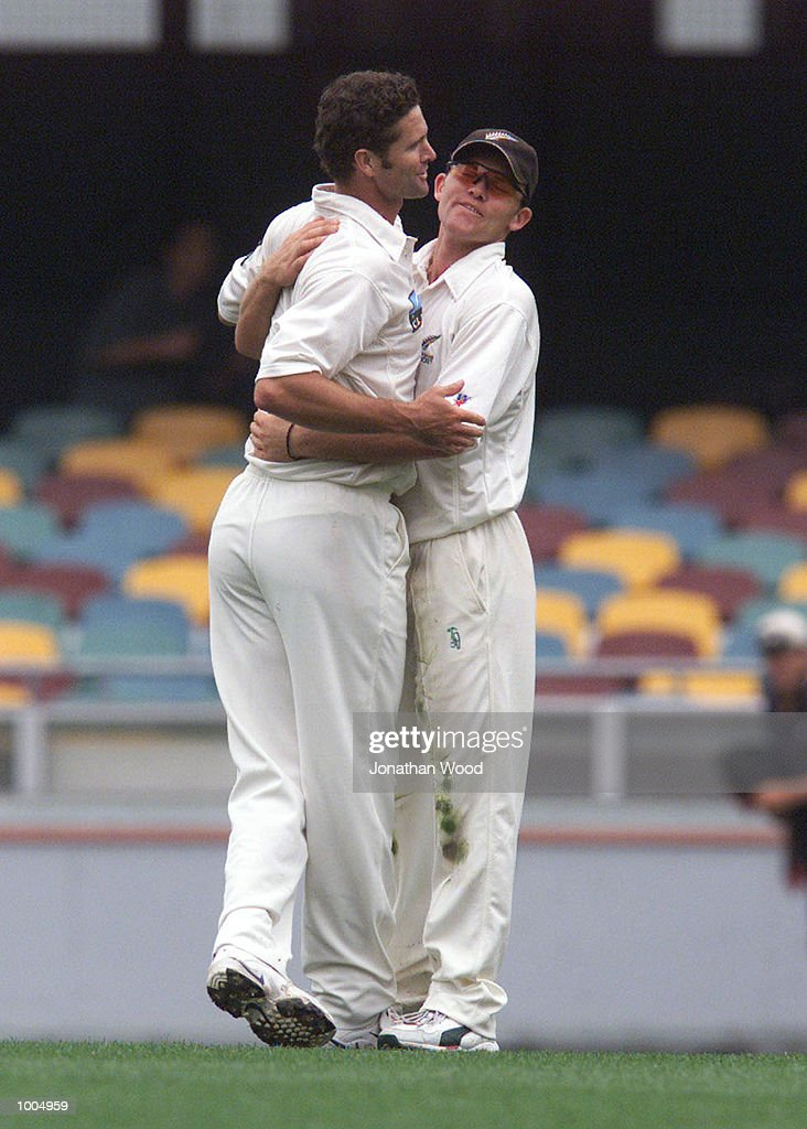 Chris Cairns and Lou Vincent of New Zealand celebrate the wicket of Adam Gilchrist of Australia during the third day of play in the first Test between Australia and New Zealand being played at the Gabba, Brisbane, Australia. DIGITAL IMAGE.Mandatory Credit: Jonathan Wood/ALLSPORT