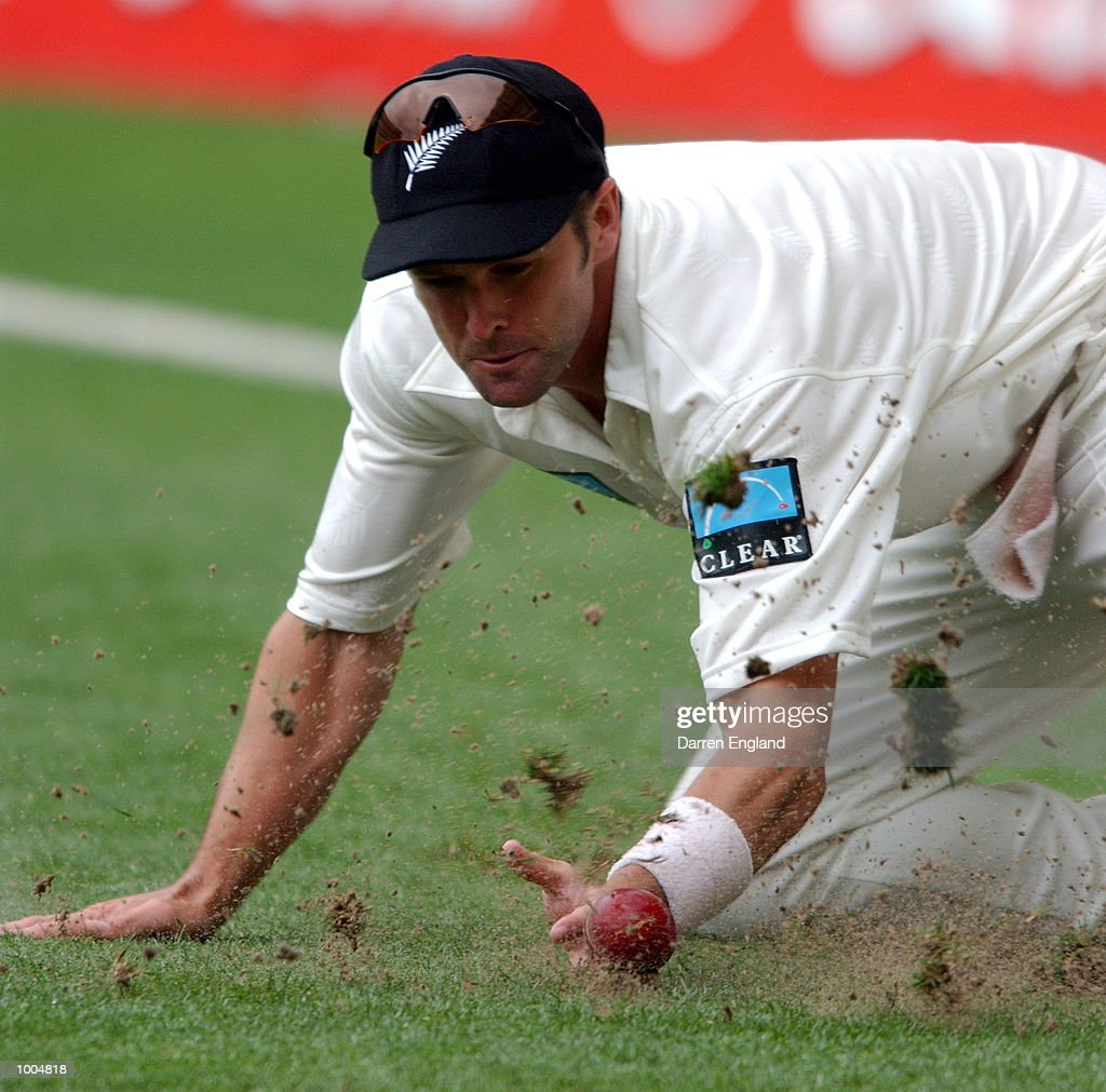 Chris Cairns of New Zealand dives to stop four runs off the batting of Brett Lee of Australia during day two of the first Cricket test between Australia and New Zealand played at the Gabba in Brisbane, Australia. DIGITAL IMAGE. Mandatory Credit: Darren England/ALLSPORT