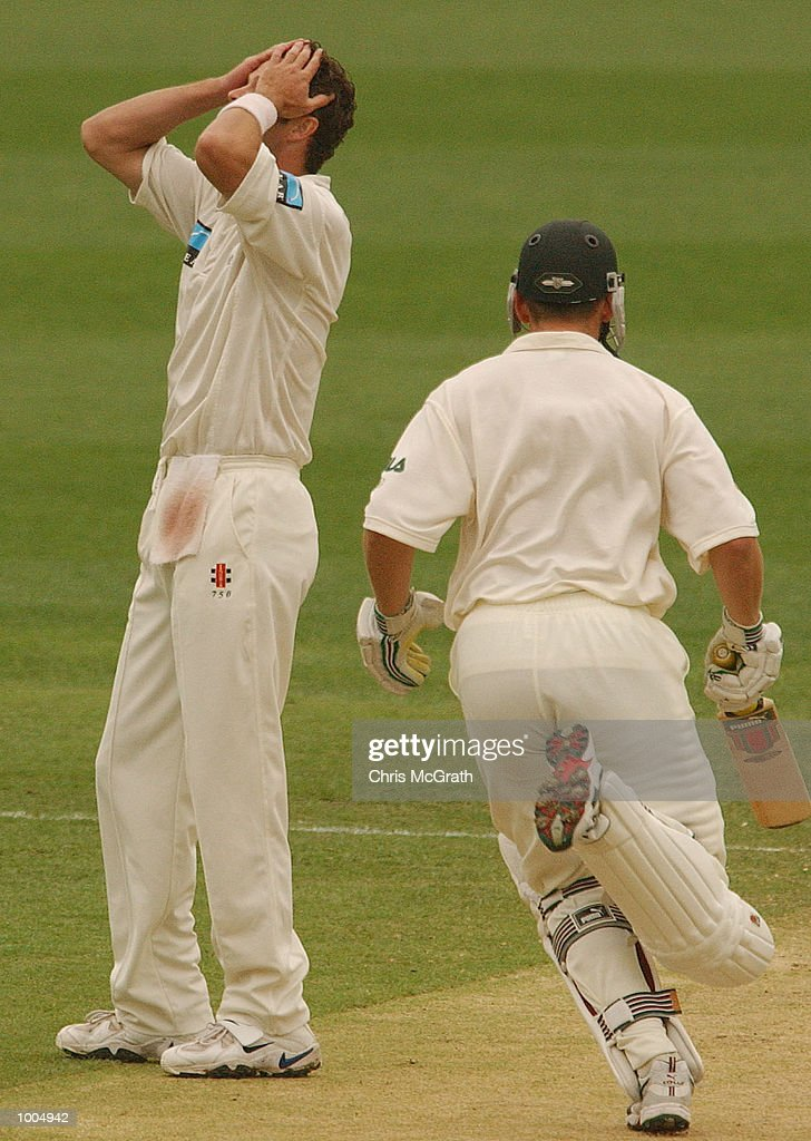Chris Cairns of New Zealand shows his frustration as Adam Gilchrist of Australia scores his 100th run during day three of the first cricket test between Australia and New Zealand held at the Gabba, Brisbane, Australia, DIGITAL IMAGE Mandatory Credit: Chris McGrath/ALLSPORT
