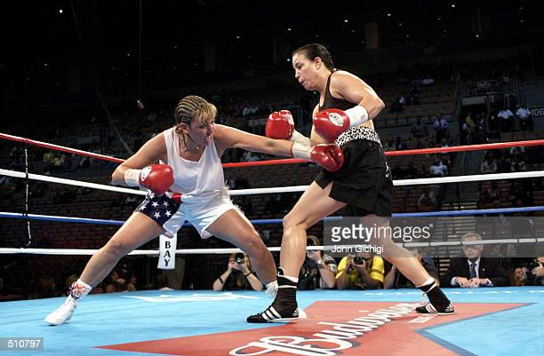 Christy Martin aims low against Lisa Holewyne during the women's pound for pound championship fight at the Mandalay Bay Resort Casino in Las Vegas...