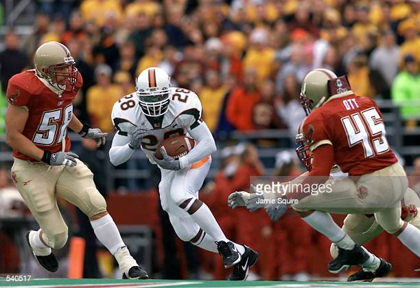 Clinton Portis of the Miami Hurricanes cuts upfield during the second half of Saturday's game between the Miami Hurricanes and the Boston College...