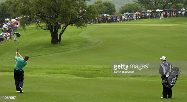 Colin Montgomerie of Scotland plays his third shot on the par 4 8th hole during the first round of the Nedbank Golf Challenge at the Gary Player...