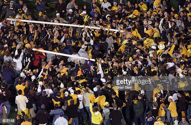Colorado fans bring down the goalposts after the football team upset the Nebraska Cornhuskers 6236 at Folsom Field in Boulder Colorado The Colorado...