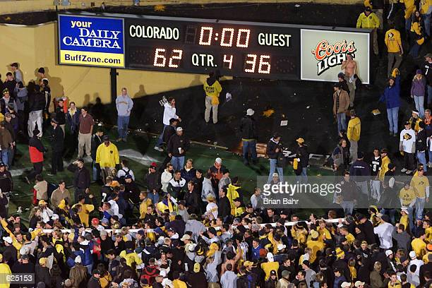 Colorado fans parade around with the south endzone goalposts after the football team upset the Nebraska Cornhuskers 6236 at Folsom Field in Boulder...
