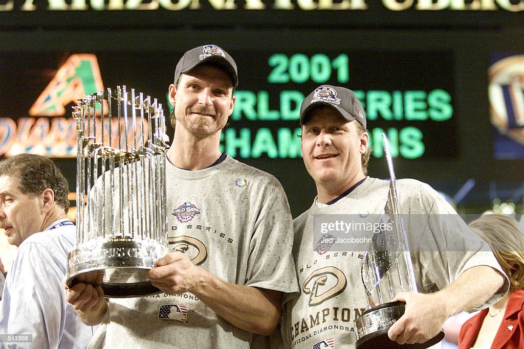 Co-MVP winners Randy Johnson #51 and Curt Schilling #38 of the Arizona Diamondbacks hold the trophys after winning the World Series over the New York Yankees at Bank One Ballpark in Phoenix, Arizona. The Diamondbacks defeated the Yankees 3-2. DIGITAL IMAGE Mandatory Credit: Jed Jacobsohn/ALLSPORT