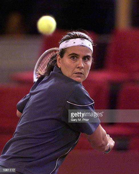 Conchita Martinez of Spain plays a backhand during her three set victory over Alicia Molik of Australia in the Federation Cup tie between Australia...