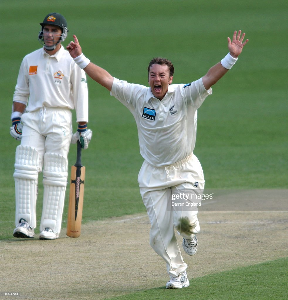 Craig McMillan of New Zealand celebrates the wicket of Steve Waugh of Australia as Justin Langer looks on during day one of the first Cricket test between Australia and New Zealand played at the Gabba in Brisbane, Australia. DIGITAL IMAGE.Mandatory Credit: Darren England/ALLSPORT