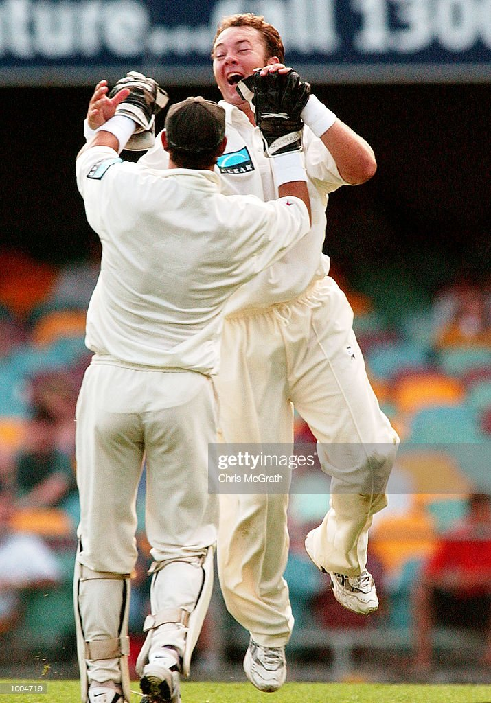 Craig McMillan of New Zealand celebrates with wicket keeper Adam Parore after taking a wicket during day one of the first cricket test between Australia and New Zealand held at the Gabba, Brisbane, Australia, DIGITAL IMAGE Mandatory Credit: Chris McGrath/ALLSPORT