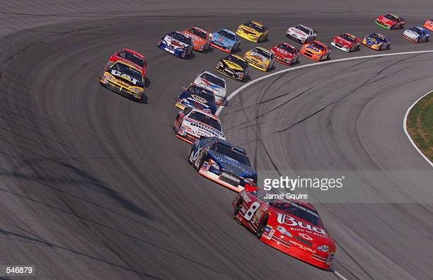 Dale Earnhardt Jr driving the Budweiser Chevrolet leads at the start of the NASCAR Winston Cup NAPA 500 at the Atlanta Motor Speedway in Hampton...