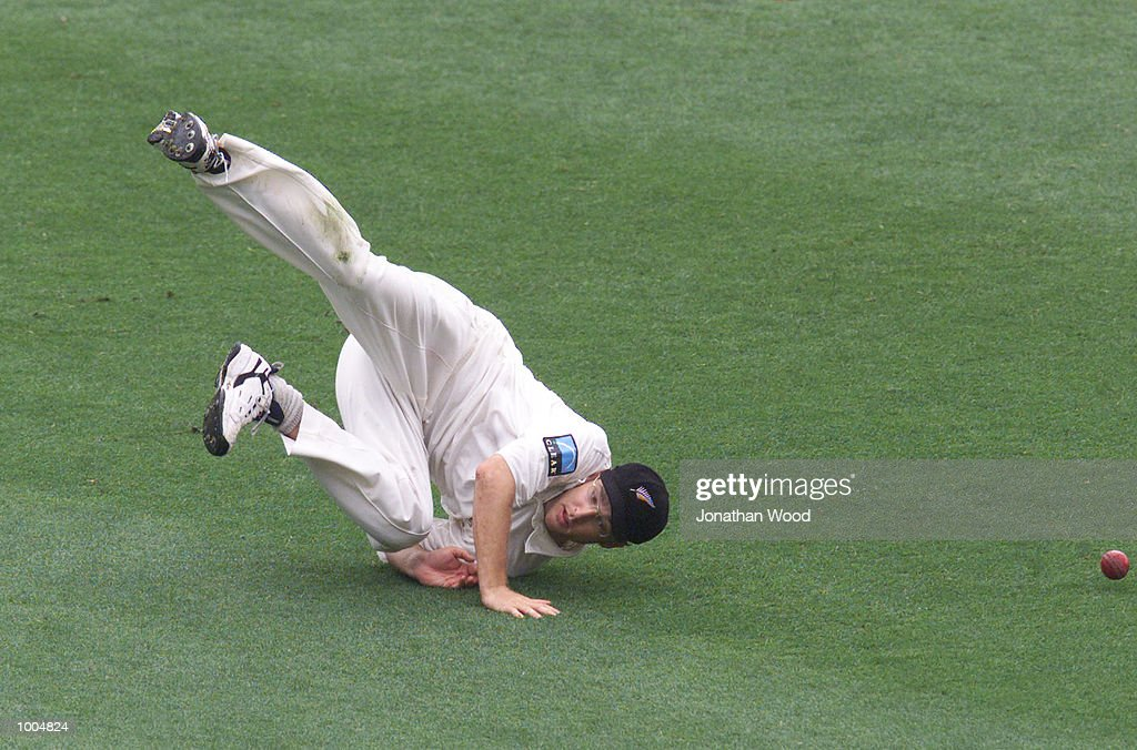 Daniel Vettori of New Zealand attempts to field the ball during the second day of play in the first Test between Australia and New Zealand being played at the Gabba, Brisbane, Australia. DIGITAL IMAGE. Mandatory Credit: Jonathan Wood/ALLSPORT