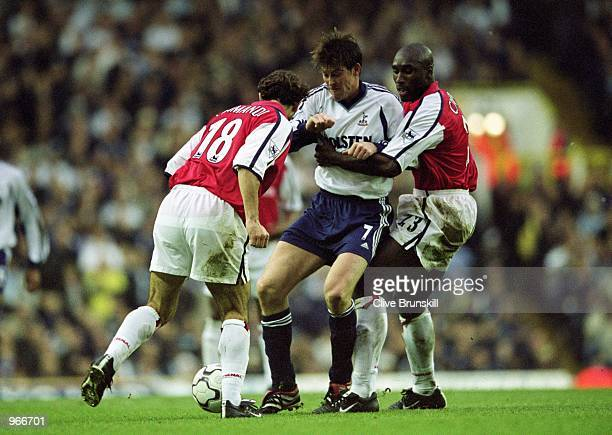 Darren Anderton of Spurs is challenged by Arsenal's Sol Campbell and Gilles Grimandi during the FA Barclaycard Premiership match between Tottenham...
