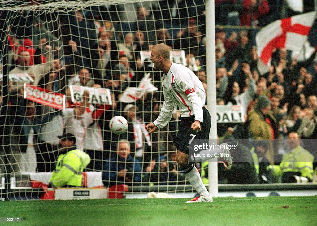 David Beckham of England celebrates after scoring the first goal during the England v Sweden International friendly at Old Trafford, Manchester. Mandatory Credit: Laurence Griffiths/ALLSPORT
