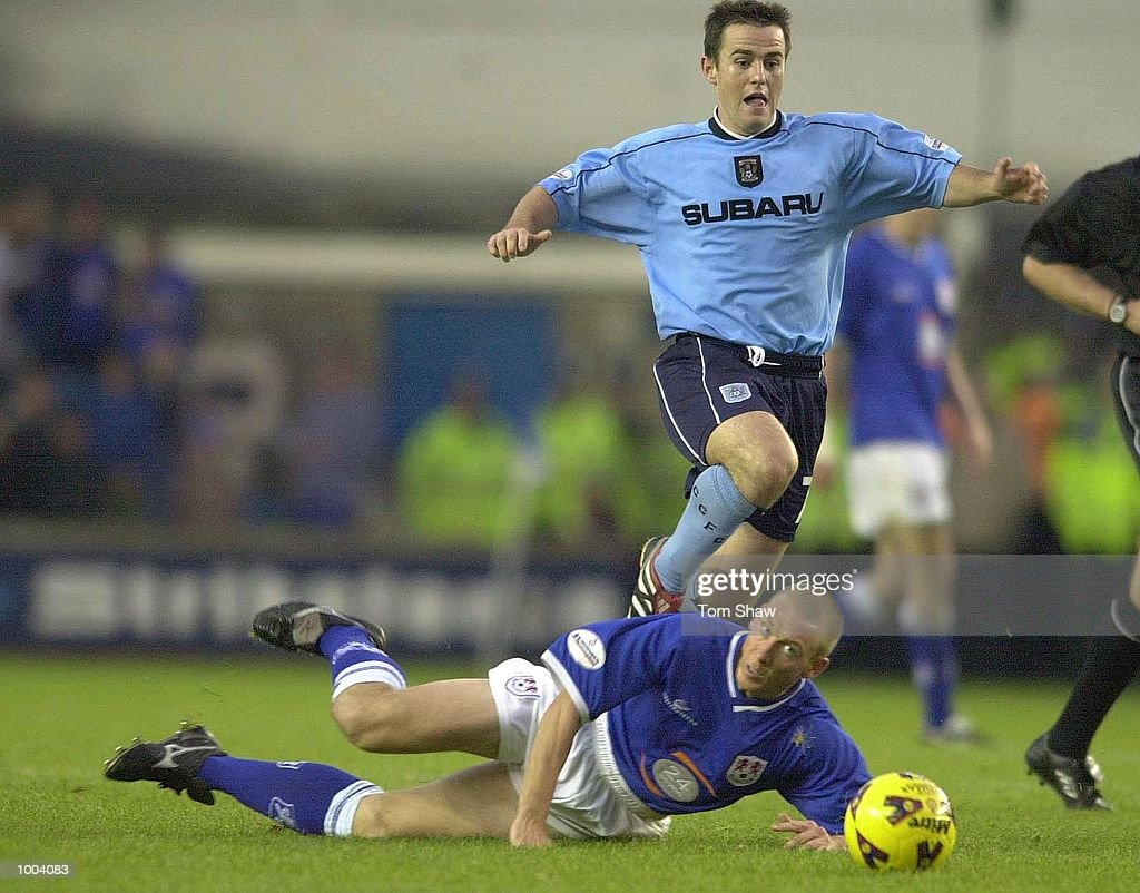 David Thompson of Coventry tussles with Sean Dyche of Millwall during the Millwall v Coventry City Nationwide League Division One match at the New Den, London. DIGITAL IMAGE. Mandatory Credit: Tom Shaw/ALLSPORT
