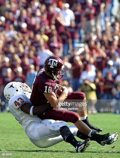 Defensive end Kalen Thornton of Texas sacks quarterback Mark Farris of Texas AM during the second half at Kyle Field in College Station Texas The...