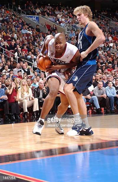 Derrick Coleman of the Philadelphia 76ers drives against Dirk Nowitzki of the Dallas Mavericks at the First Union Center in Philadelphia Pennsylvania...