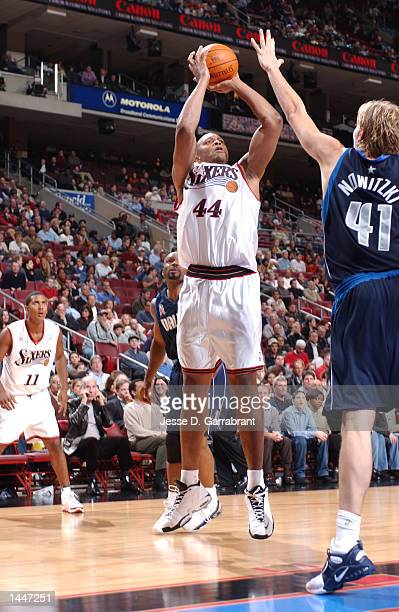 Derrick Coleman of the Philadelphia 76ers puts up a shot over Dirk Nowitzki of the Dallas Mavericks at the First Union Center in Philadelphia...