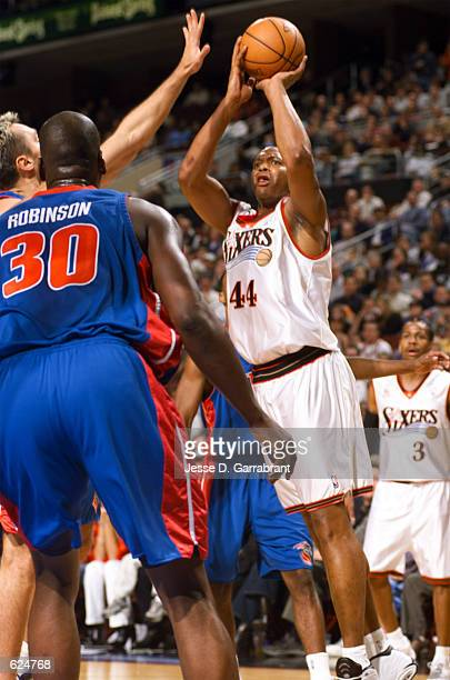 Derrick Coleman of the Philadelphia 76ers shoots a jumper over the Detroit Pistons during the first half at the First Union Center in Philadelphia...