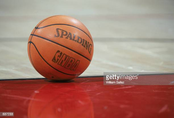 Detail of the ball on the floor during the NBA game between the Denver Nuggets and the Sacramento Kings at the Pepsi Center in Denver, Colorado. The...