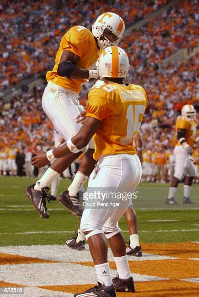 Donte Stallworth of Tennessee celebrates his second quarter two point conversion with teammate Kelly Washington to give the Vols a 14-0 lead over...