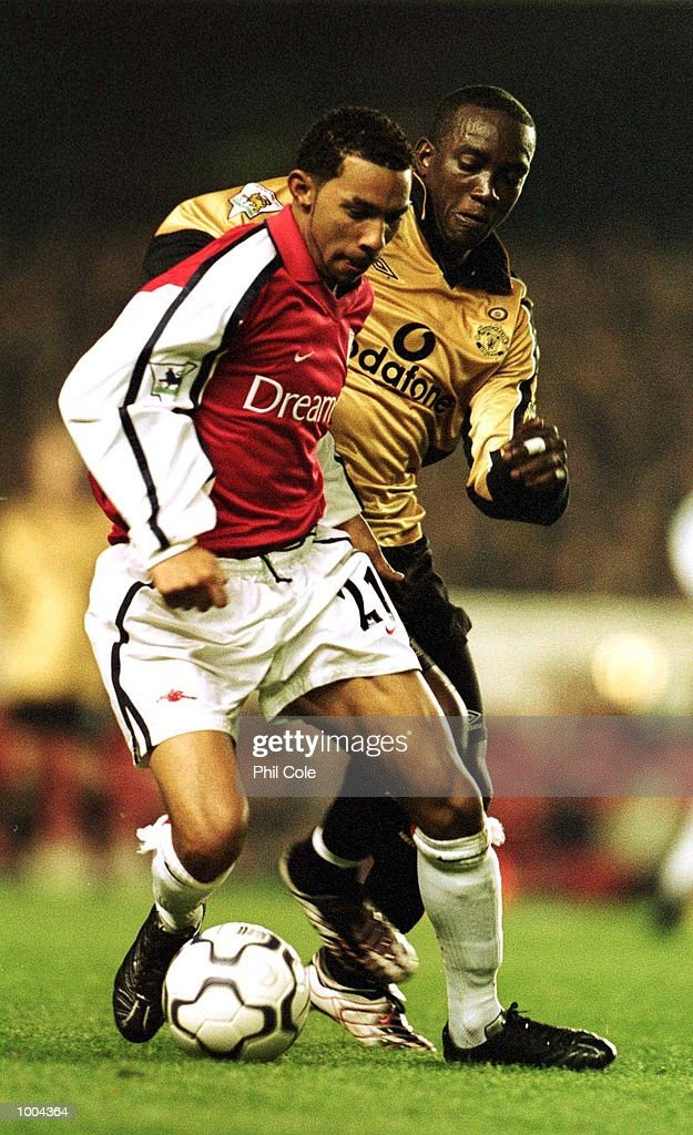 Dwight Yorke of Manchester United tries to tackle Jermaine Pennant of Arsenal during the Worthington Cup, Third Round match between Arsenal and Manchester United at Highbury, London. Mandatory Credit: Phil Cole/ALLSPORT