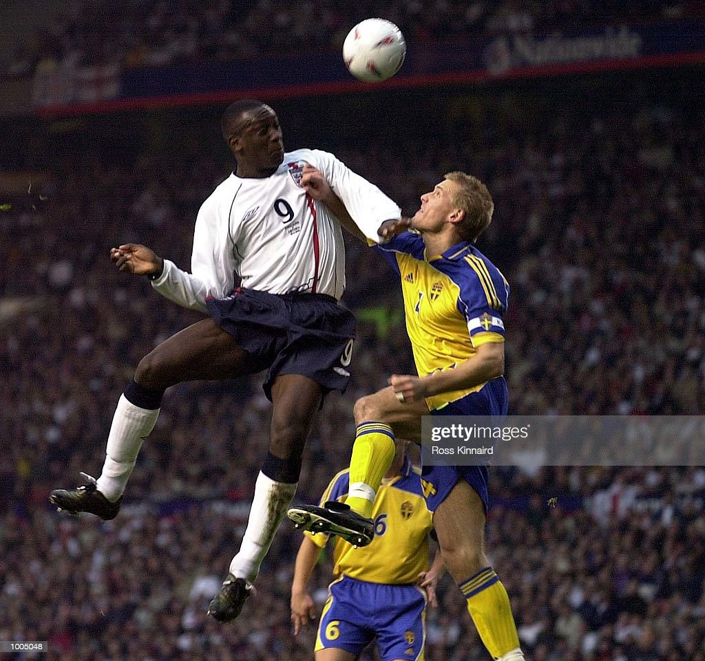 Emile Heskey of England battles with Johan Mjallby of Sweden during the England v Sweden International friendly at Old Trafford, Manchester. DIGITAL IMAGE Mandatory Credit: Ross Kinnaird/ALLSPORT