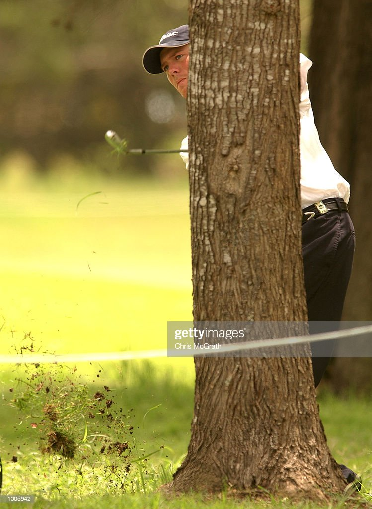 Ernie Rose of Australia chips around a tree during the second round of the Australian PGA Championships being played at Royal Queensland Golf Club, Brisbane, Australia. DIGITAL IMAGE Mandatory Credit: Chris McGrath/ALLSPORT