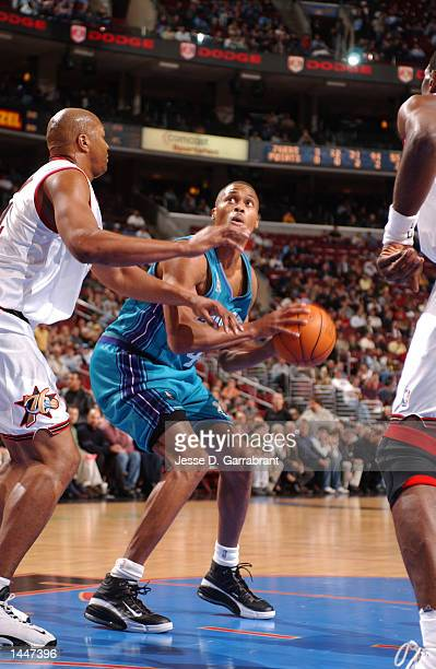 Former teammates PJ Brown of the Charlotte Hornets battles against Derrick Coleman of the 76ers during a game at First Union Center in Philadelphia...