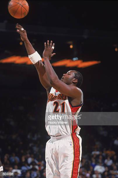Forward Danny Fortson of the Golden State Warriors shoots a jump shot during the NBA game against the New Jersey Nets at the Arena in Oakland in...