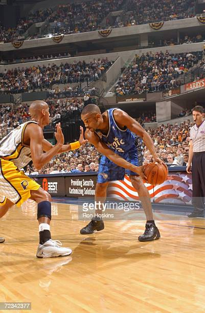 Forward Grant Hill of the Orlando Magic faces up guard Reggie Miller of the Indiana Pacers during the NBA game at Conseco Fieldhouse in Indianapolis...